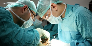 Surgeons performing a bowel cancer operation